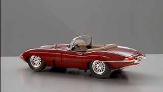 Rear 3/4 view of a scale model of the E-Type